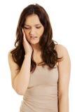 Mujer joven con un dolor de muelas Fotos de archivo