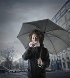 Mujer joven con un frío Imagenes de archivo