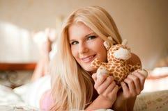 Mujer joven con un juguete Fotos de archivo