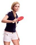Mujer joven con un ping-pong de la raqueta Imagen de archivo libre de regalías