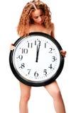 Mujer joven con un reloj de pared fotografía de archivo