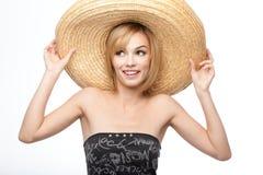 Mujer joven con un sombrero del sombrero Imagen de archivo