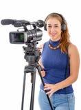 Mujer joven con una cámara de vídeo, en el fondo blanco Foto de archivo