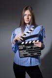 Mujer joven con una chapaleta de la película Fotografía de archivo libre de regalías