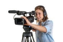 Mujer joven con una cámara de vídeo Imagenes de archivo