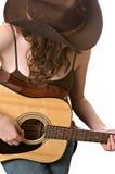 Mujer joven con una guitarra Fotografía de archivo libre de regalías