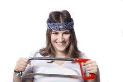 Mujer joven con una herramienta Fotografía de archivo libre de regalías