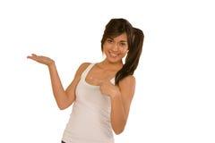 Mujer joven con una mano abierta, palma para arriba Fotografía de archivo