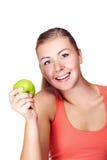 Mujer joven con una manzana Fotografía de archivo