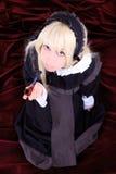 Mujer joven cosplay hermosa en un traje. Fotografía de archivo