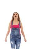 Mujer joven de griterío enojada con el puño apretado fotos de archivo