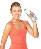 Mujer joven de la aptitud con la botella de agua Imágenes de archivo libres de regalías