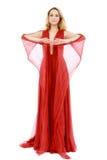 Mujer joven de la belleza en alineada roja que agita Fotos de archivo libres de regalías