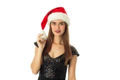 Mujer joven de la belleza en el sombrero de santa Foto de archivo libre de regalías