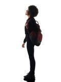 Mujer joven de la muchacha del adolescente que se coloca de mirada para arriba de la silueta de la sombra Fotos de archivo libres de regalías
