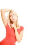 Mujer joven de pensamiento Foto de archivo