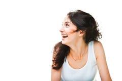 Mujer joven de risa en blanco Foto de archivo
