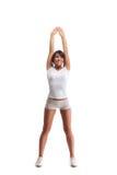 Mujer joven del deporte que hace los ejercicios aislados en blanco Foto de archivo libre de regalías