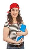 Mujer joven del estudiante con el casquillo Imagen de archivo