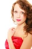 Mujer joven del retrato con el pelo rizado marrón largo de la belleza aislado Imágenes de archivo libres de regalías