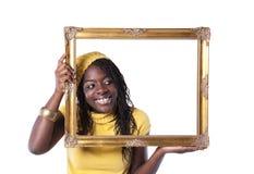 Mujer joven dentro de un marco Imagen de archivo libre de regalías