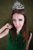 Mujer joven Disgusted en corona Imagenes de archivo