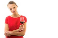 Mujer joven elegante que come un vidrio de vino rojo Imágenes de archivo libres de regalías