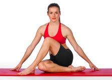 Mujer joven en actitud de la yoga Fotografía de archivo
