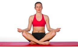 Mujer joven en actitud de la yoga Imágenes de archivo libres de regalías
