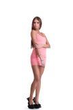 Mujer joven en alineada rosada Imagenes de archivo