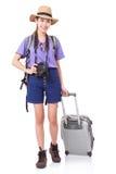 mujer joven en caminar casual con el bolso del viaje con una cámara Foto de archivo libre de regalías