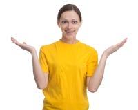 Mujer joven en camiseta amarilla en blanco Imagen de archivo libre de regalías