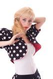 Mujer joven en capa del punto de polca Imágenes de archivo libres de regalías