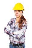 Mujer joven en casco amarillo de la construcción Imagenes de archivo
