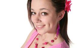 Mujer joven en color de rosa Imagen de archivo