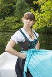 Mujer joven en dirndl Foto de archivo libre de regalías