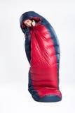 Mujer joven en el saco de dormir Foto de archivo libre de regalías