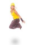 Mujer joven en el salto amarillo del vestido Fotografía de archivo