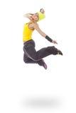 Mujer joven en el salto amarillo del vestido Imagenes de archivo