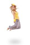 Mujer joven en el salto amarillo del vestido Imagen de archivo libre de regalías