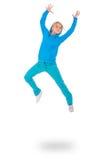 Mujer joven en el salto azul del vestido Foto de archivo libre de regalías