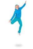 Mujer joven en el salto azul del vestido Fotografía de archivo libre de regalías