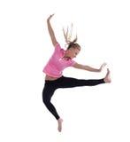 Mujer joven en el salto de altura aislado Foto de archivo libre de regalías