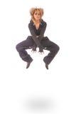 Mujer joven en el salto negro del vestido Imagenes de archivo
