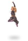 Mujer joven en el salto negro del vestido Imágenes de archivo libres de regalías