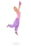 Mujer joven en el salto rosado del vestido Fotos de archivo