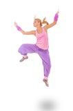 Mujer joven en el salto rosado del vestido Imagen de archivo