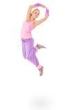 Mujer joven en el salto rosado del vestido Fotografía de archivo