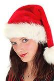 Mujer joven en el sombrero de Santa Imagen de archivo libre de regalías