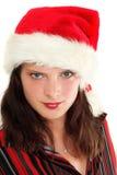 Mujer joven en el sombrero de Santa Imágenes de archivo libres de regalías